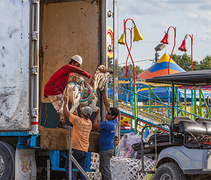Carnival workers unloading